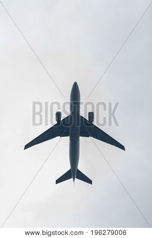 Photo of airplane in sky with clouds