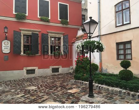 LVIV UKRAINE - JULY 11: Beautiful city landscape - Mons Pius Restaurant in the building of the first pawnshop bank in Lviv on July 11 2017 in Lvov Ukraine