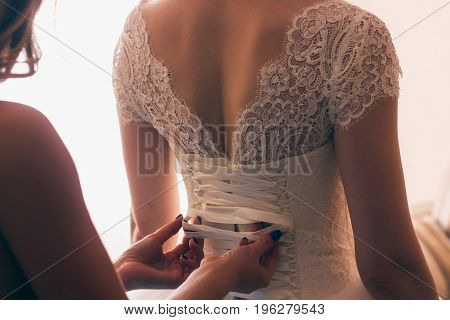lace wedding dress back of a young bride.