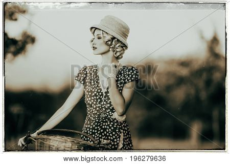 Classic Black And White Photo Of 1930S Fashion Woman In Summer Dress Standing With Bicycle In Rural