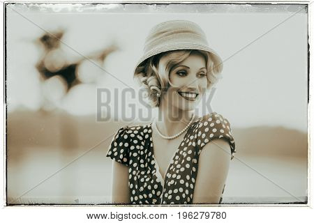 Classic Black And White Photo Of Smiling Woman Wearing Retro 1920S Clothing. Standing In Rural Summe