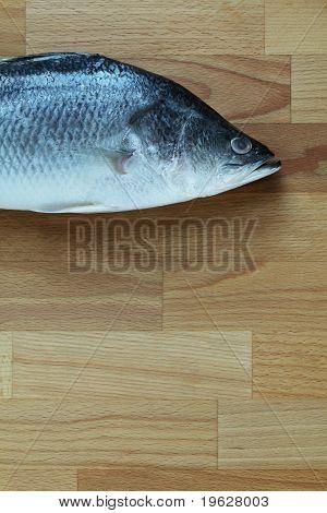 Sea bass on a chopping board