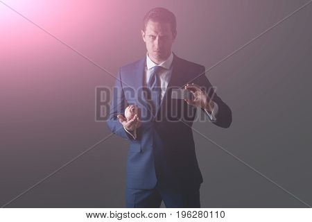 Confident Businessman Holding Piggy Bank And Bank Card