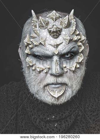 Horror Man Or Monster With Thorns On Face With Makeup