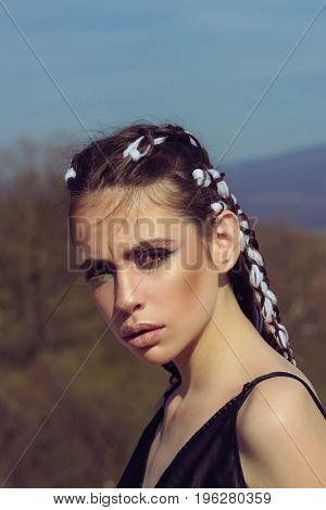 Girl With Fashionable Makeup On Blue Sky Background.