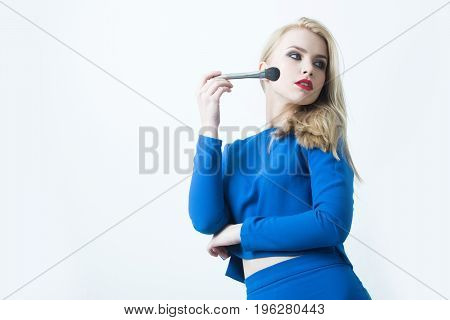 Woman With Makeup Brush Applying Powder On Face