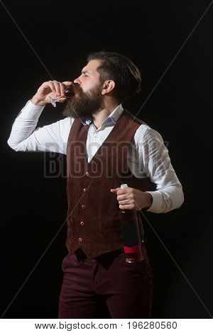 Hipster With Bottle Drinking Glass Of Red Wine