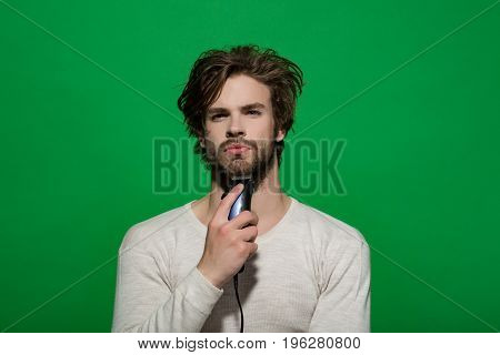 Male Beauty, Man Shaving With Electric Razor In Morning