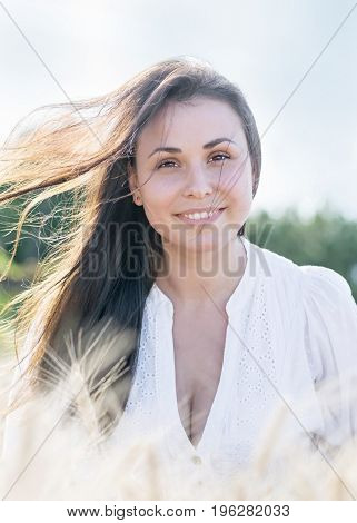 Beautiful young sexy woman with Fluttering long hair in the wind