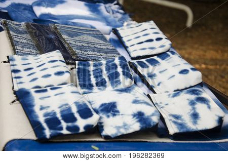 Handmade indigo fabric pocket money souvenirs for travelers people sale at organic street market in Nakhon Ratchasima Thailand