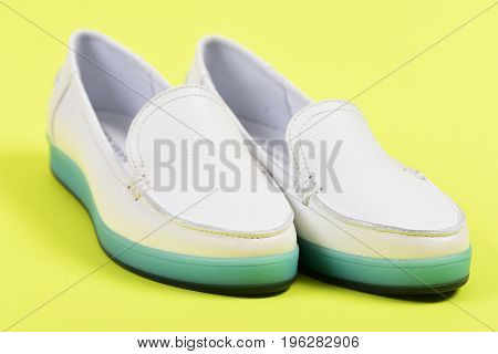 Pair Of Female Shoes Isolated On Yellow Background