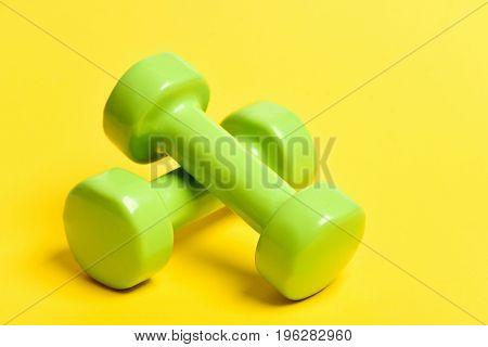 Pair Of Green Lightweight Plastic Dumbbells For Light Training