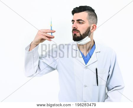 Doctor With Beard Holds Syringe. Medicine And Recovery Idea