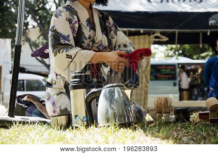 Japanese Women Making Sado Chanoyu Or Japanese Tea Ceremony, Also Called The Way Of Tea At Outdoor