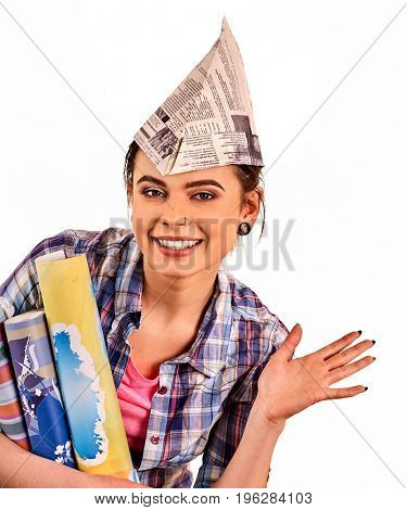 Repair home woman holding wallpaper roll. Girl in newspaper cap renovation apartment on isolated. Teenager started construction and redecorating.