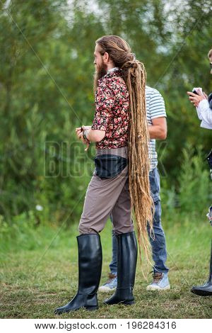 Young Blonde Man With Long Rasta Dreadlocks