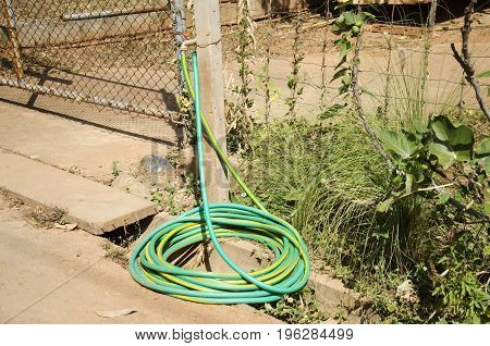 Faucet water tap connect with rubber hose or hosepipe at outdoor in garden