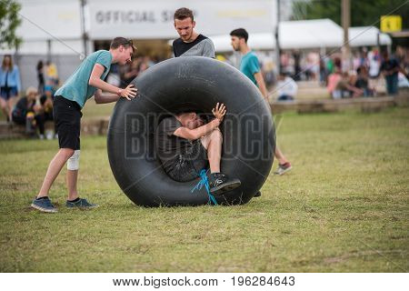Young Adults Playing With An Inner Tube Of A Tractor