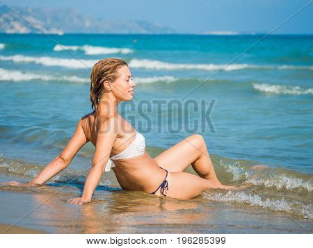 Classy woman on the beach in Vietnam
