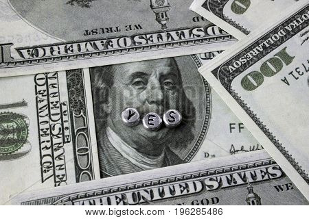 On banknotes an inscription from the alphabet of beads, YES