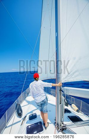 Woman Sailing On Yacht in Greece. Family holidays