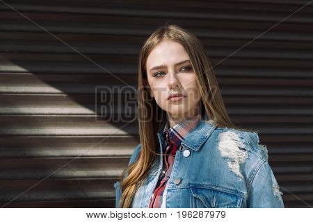 Portrait of beautiful stylish young woman in jeans jacket