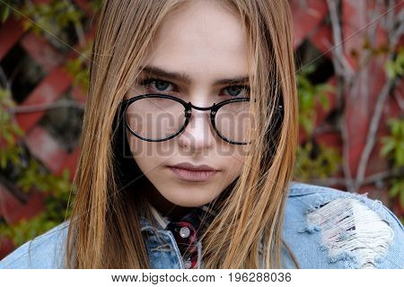 Close up portrait of beautiful young woman in eyeglasses