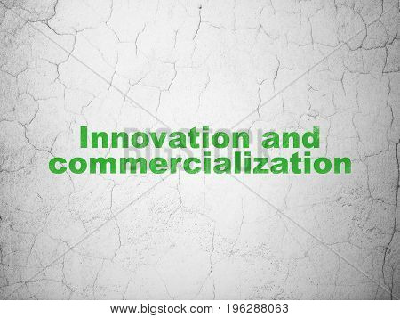Science concept: Green Innovation And Commercialization on textured concrete wall background