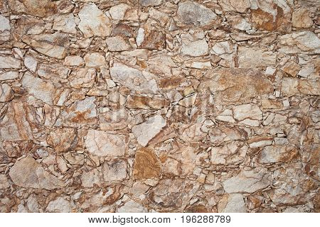 Colorful old stone wall texture, background. Stone fence.  Stone wall background