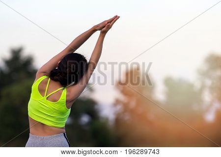 Young asian woman runner resting after workout session