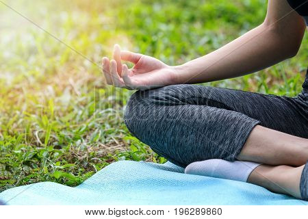 Close Up Of Young Girl Doing Yoga (lotus Pose)