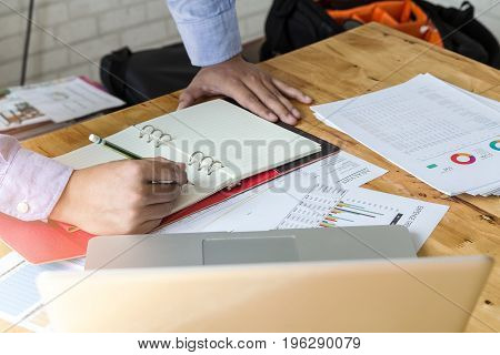 Businessman Holding A Pencil For Working On His Plan Project