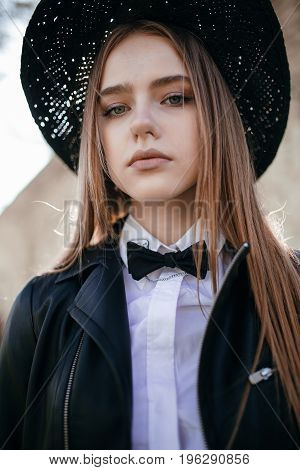 Portrait of beautiful stylish young woman in black hat