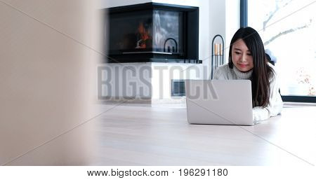 young attractive Asian woman using laptop on floor at home in the living room