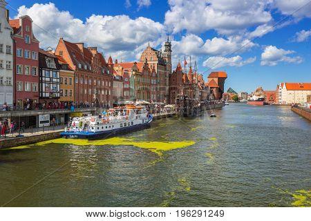 GDANSK, POLAND - JULY 13, 2017: Summer scenery of Motlawa river in Gdansk in summer day, Poland. Gdansk is the historical capital of Polish Pomerania.