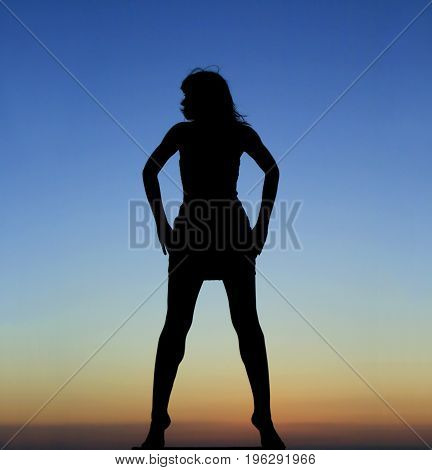 Silhouette of dancing girl in the sunset