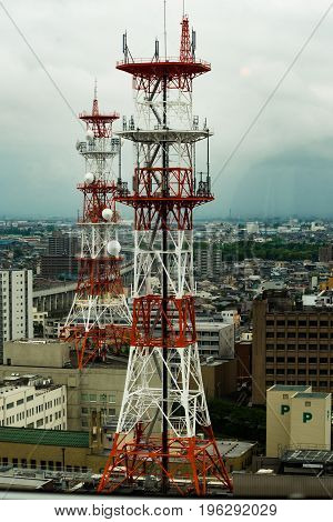 Telecomunication tower on building rooftop high view.