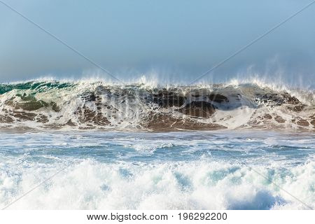 Waves upright sand water crashing ocean power danger landscape..