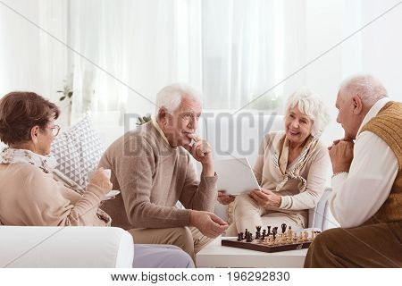 Two old friends competing over a game of chess