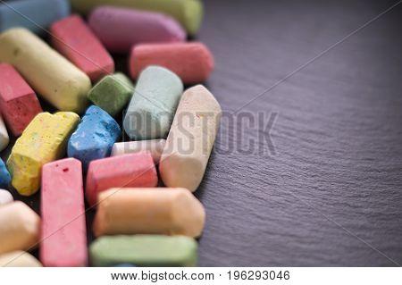 Colour chalk. Colored chalk on a black background. School studies