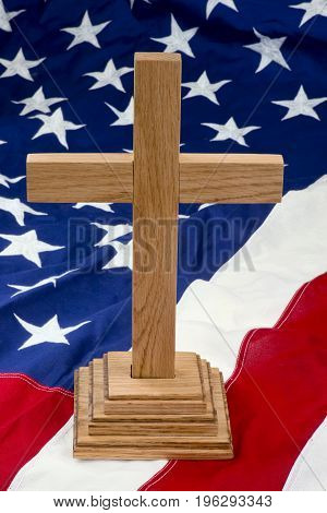 American wooden cross on the USA flag.