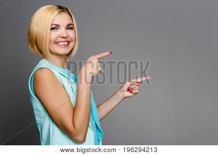Blonde on clean gray background