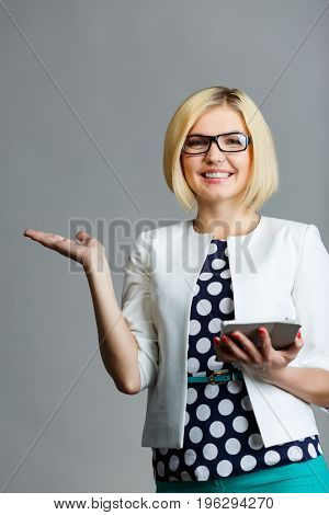 Woman with smartphone holds palm