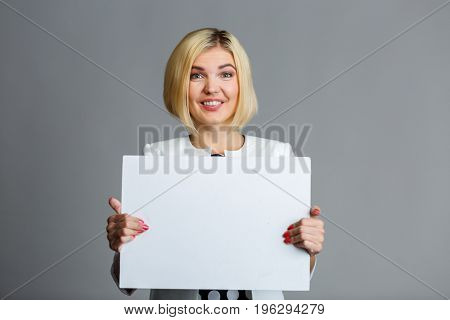 Photo of girl with paper