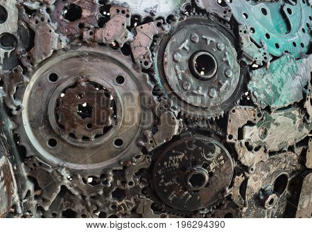 Abstract Background : Used metal spare parts welded altogether.