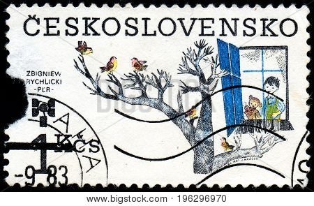 UKRAINE - CIRCA 2017: A stamp printed in Czechoslovakia shows 9th Biennial of Illustrations for Children and Youth Zbigniew Rychlicki circa 1983