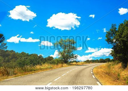 Road and clouds. Travel vacation holiday concept.
