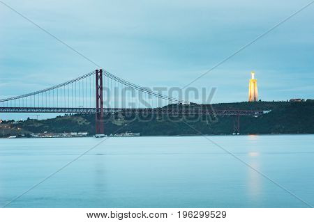 bridge and Cristo Rei in Lisbon at dusk Portugal