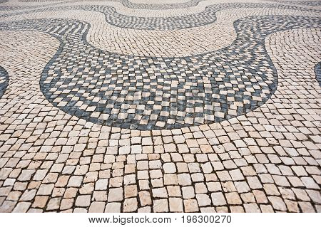 Traditional Portuguese pavement (cobblestone) in Lisbon Portugal