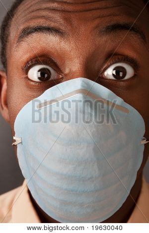 Frightened Man In Surgical Mask